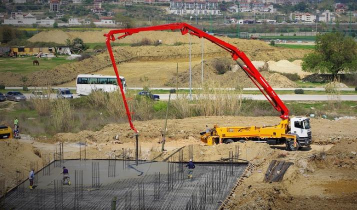 this image shows concrete pump line crane